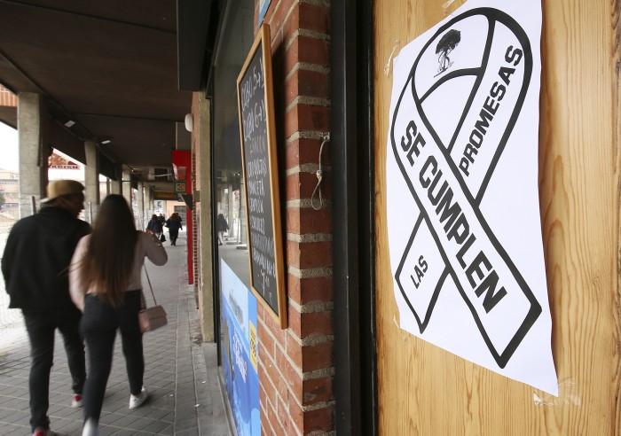 cartel protesta plaza los belgas